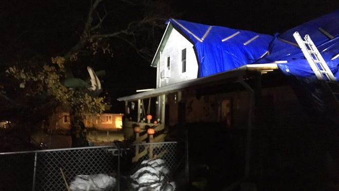 A home on Ohio 60 just north of Hayesville is covered with tarps Sunday night after a portion of its roof was blown off by a strong line of storms that passed through shortly after 5:30 p.m. Tom Kosht, who lives in the home with his wife and father, said no one was injured.