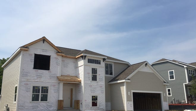 Permits to construct new homes are down slightly this year in metro Milwaukee.