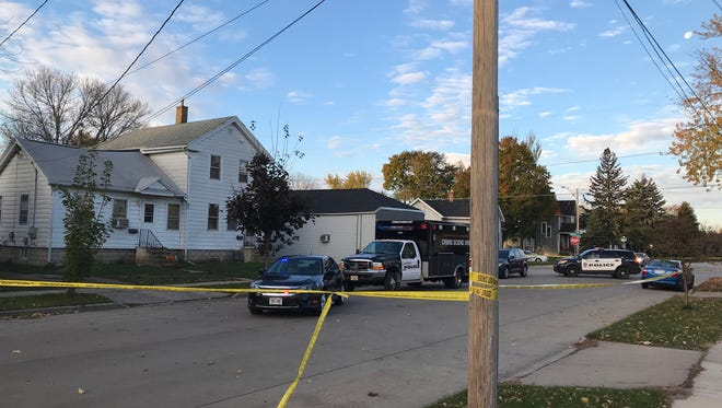 Authorities investigate at the scene of a fatal shooting that happened Nov. 5 in the 800 block of Waguoo Avenue in Oshkosh.