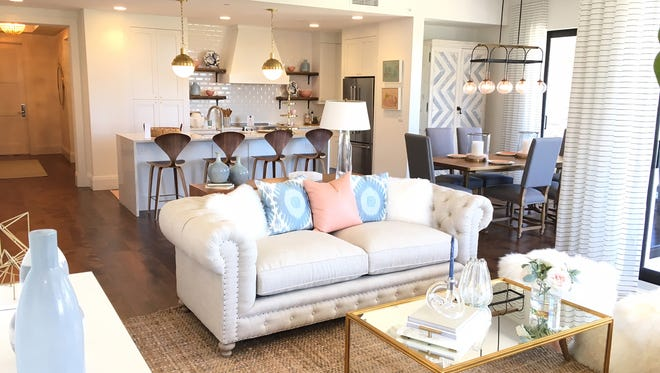 Renee Gaddis Interiors created a modern coastal look for The Ronto Group's furnished Phase II Denison model now open for viewing at Naples Square.