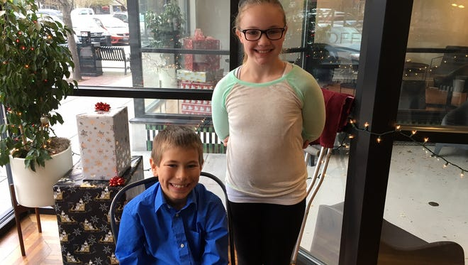 Union STEM fifth-graders Cameron Templeton and Presley Lannon say they enjoy the school's new house system.