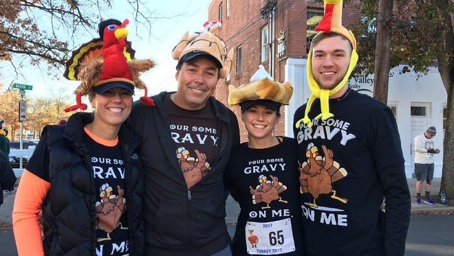 Darlene Anno, her husband, John, their daughter, Brittney and Brittney's boyfriend Justin, get ready to run in the 2017 CEA/Johanna Foods Turkey Trot in Flemington on Thanksgiving morning.