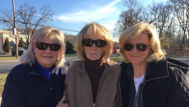 From left, siblings Katie Squier, Madeline Fornaro and Susan Degan. Fornaro's restaurant, Billy & Madeline's Red Room Tavern, was destroyed by fire on Nov. 27, 2017.