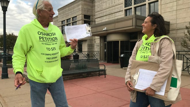 Mark and Shawn Kelderman seek signatures on a petition to reduce Oshkosh's fine for marijuana possession at the Oshkosh Public Library, Oct. 26.