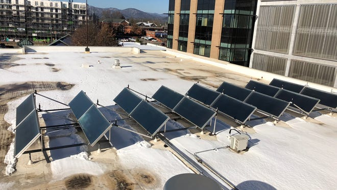 Buncombe County installed solar panels on the roof of the Health and Human Services as part of its goal to reaching 100 percent renewable energy in the county. North Carolina was ranked No. 2, behind only California, in a recent report on solar energy by the Solar Energy Industries Association.