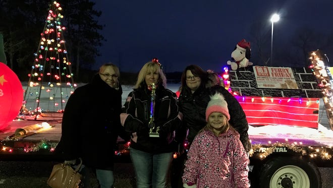 Animal Control volunteers won the grand marshal prize at the Yale Christmas Parade. From left are Carol Miller, Sue Jones, Sara Miller and Ava Freeman.