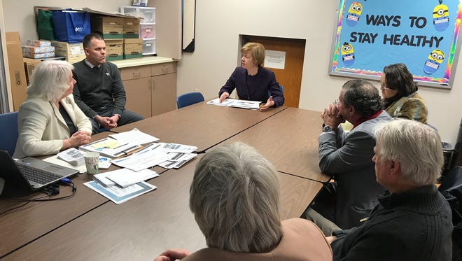 U.S. Sen. Tammy Baldwin met with representatives for N.E.W. Community Health Clinic Friday to discuss federal funding lapses and its impact on local programs.