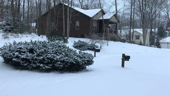 The snow came to Candler overnight, as about 3 inches of snow is on the ground Wednesday morning.