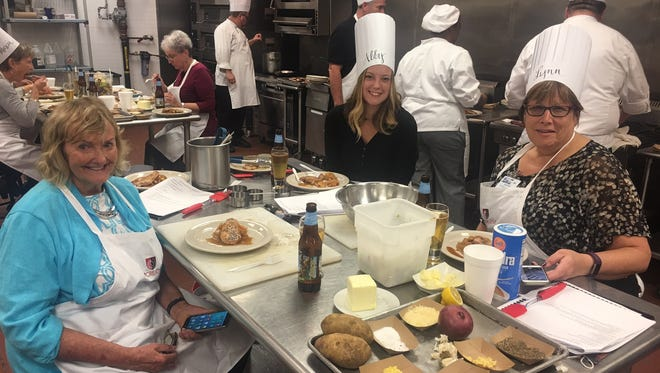 Students enjoy a three-course cooking class with all things apples in October.