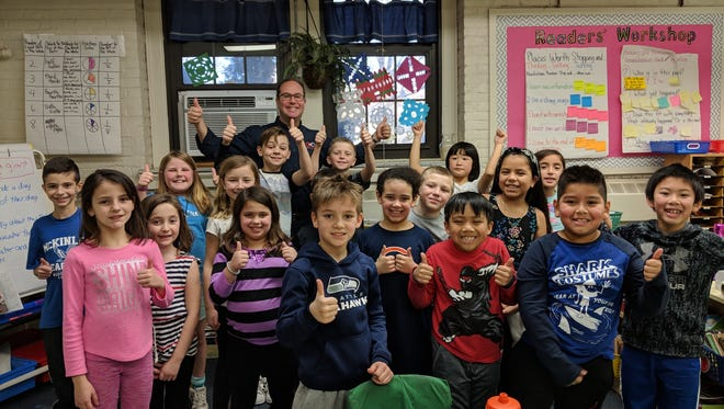 """Dr. Scott Gersch (back) with Lauren Caruana's third-grade class at McKinley Elementary School in Westfield. Everyone is giving a """"Thumbs Up to Healthy Teeth!"""""""