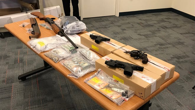 The State Attorney General's Organized Crime Task Force and county and local law enforcement officials recovered drugs, cash and guns in a major drug bust.