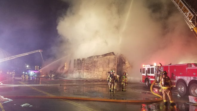 Firefighters from Delton and other departments battle a blaze Wednesday morning that destroyed a maintenance building at the Mt. Olympus Theme Park.