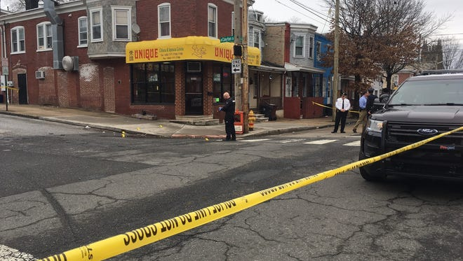 Police investigate a reported shooting at Fourth and Clayton streets in Wilmington Friday afternoon.