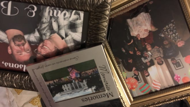 Family photos, reflecting four generations of Helen's family, are among the decorations in her nursing home room.