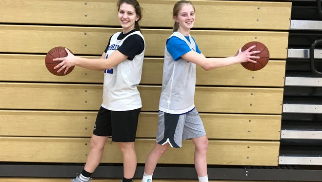 Juniors Ashley Groshek (left) and Grace Moe give Amherst an abundance of riches at the point guard position. The duo has been instrumental in helping the Falcons reach the state tournament for the first time since 2009.