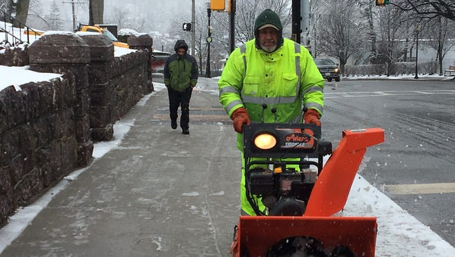 Morris County Buildings and Grounds employee Dave McGuire snow-blows in front of the Morris County courthouse on March 7, 2018.