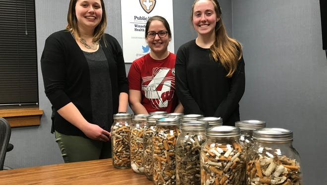 Lynnsey Erickson, Autumn Linsmeier and Grace Halstead, members of the Winnebago County Health Department's re:TH!NK Youth Coalition, worked for four years to promote a recently passed smoking ban in Oshkosh. They collect cigarette butts from parks and keep them to illustrate the scope of cigarette butt litter.