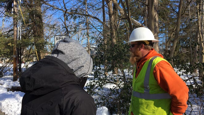 Morristown Councilwoman Alison Deeb chats with a worker from AEP Ohio, who showed up Sunday morning with JCP&L to address power outages in the Fourth Ward.