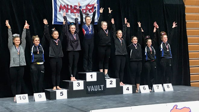 Howell's Taylor Gillespie (center podium) won the Division 2 vault state championship on Saturday.