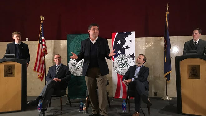Three GOP candidates for governor: Sen. Patrick Colbeck, center; Dr. Jim HInes, seated left, and Lieutenant Gov. Brian Calley, seated right, took part in a town hall meeting at MSU on Tuesday night.