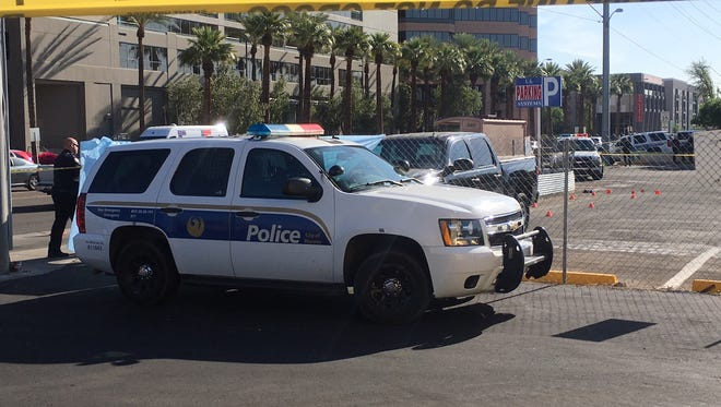 A man wrapped in blankets was found dead beneath a truck in a parking lot near Thomas Road and Central Avenue in Phoenix on April 3, 2018.