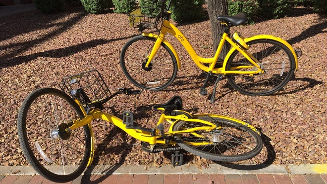 Dockless Ofo bikes parked in downtown Tempe, pictured on April 4, 2018.