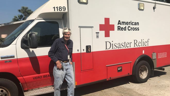 American Red Cross volunteer Bob Livingston poses by the emergency response vehicle he drives for Florida's Coast to Heartland Chapter.