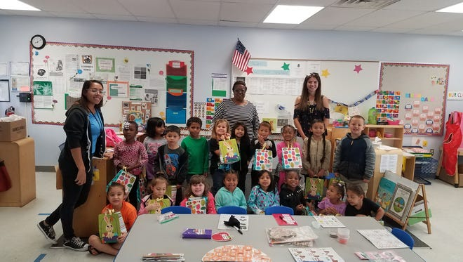 The Sebastian River High School Key Club recently delivered 40 Easter bags for preschool children in the Head Start program at Citrus Elementary. With help from the Vero Beach Kiwanis club, the Key Club was able to fill the Easter bags with toys and candy. Pictured are Sebastian River High School Key Club President Katie Toperzer with Mrs. Francis' class.