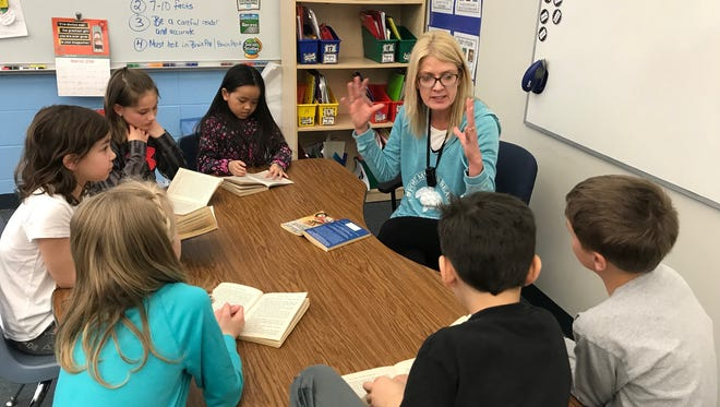 Suamico Elementary third-grade teacher and Golden Apple winner April White works with her students on vocabulary as they read The Mouse and the Motorcycle by Beverly Cleary.