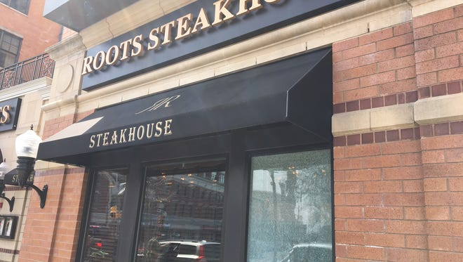 The window on the right of Roots Steakhouse in Morristown was one of two businesses damaged Thursday night by BB-gun shots.