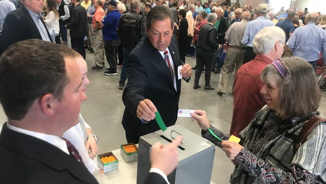 Members of the Washington County Republican Party, including county commission candidate Gil Almquist, center, hand in ballots during a vote at the party's county convention in Hurricane on Saturday.
