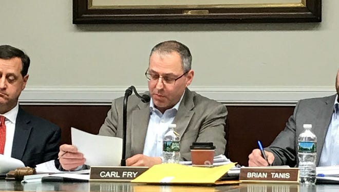 Zoning board chairman Carl Fry sets a hearing date for the revised Vista project.
