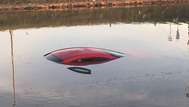 A red car plunged into a pond early Saturday near the Eden Square Shopping Center along U.S. 40 in Bear, police said.