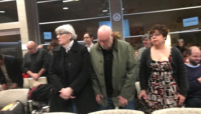 A large, supportive contingent of library fans showed up at the city council meeting.