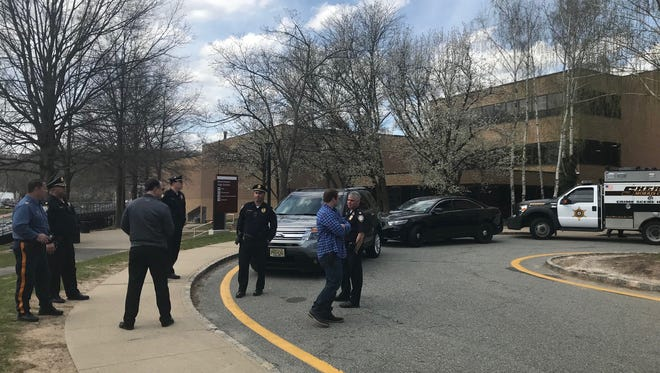 Police and security officials outside Morristown High School after a bullet found in the ground there set off a security alert. April 24, 2018.