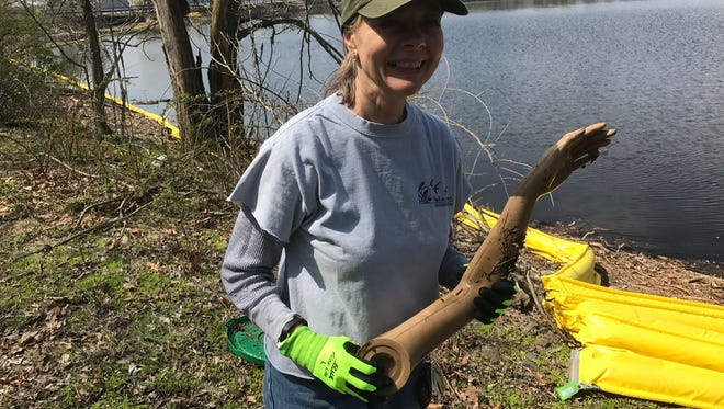 Lynn Kramer with one of the stranger things she found while cleaning the Woodcliff Lake Reservoir on Saturday. The rest of the mannequin was not found.