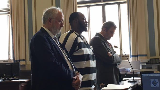 Jason Rutherford standing between his attorneys during his plea and sentencing Thursday in Hamilton County Common Pleas Court.
