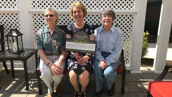 From left Judi Adams; Kate Shepard, executive director of the Reformed Church Home in Old Bridge, and Linda Ranft were among those that attended a ribbon cutting for the Don Adams Tranquility Garden on Wednesday at the home.