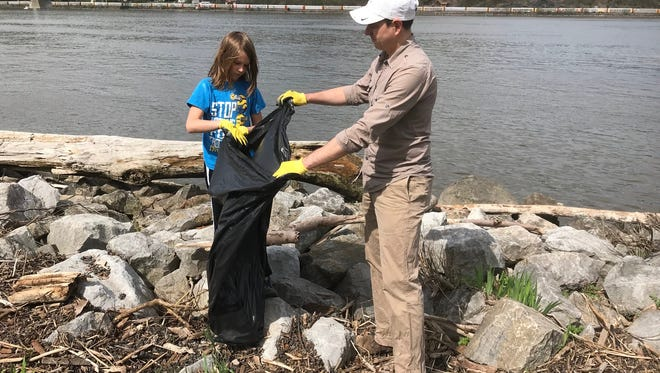 David Holdreith, a New York City resident who owns a weekend home in LaGrangeville, right, collects trash with his son, Henry, at Waryas Park in the city of Poughkeepsie on Saturday. Holdreith and his family took part in the seventh annual Riverkeeper Sweep.