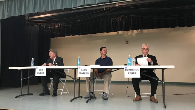 The candidates prepare to speak at a forum sponsored by the League of Women Voters.