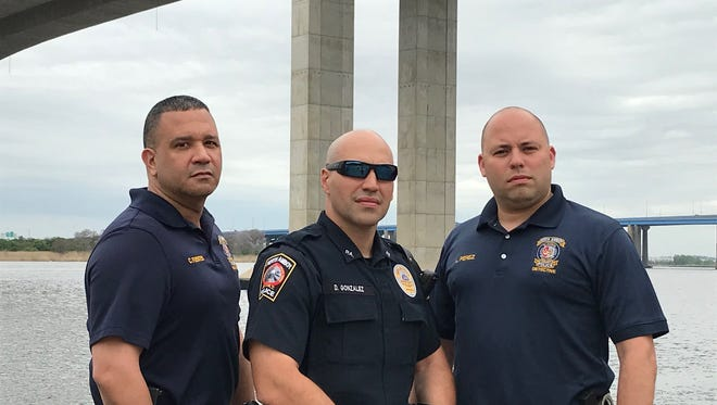Perth Amboy Detective Crescencio Fuentes, Officer Danny Gonzalez and Detective Luis Perez are receiving valor awards from the 200 Club of Middlesex County for rescuing a man planning to jump off the Victory Bridge.