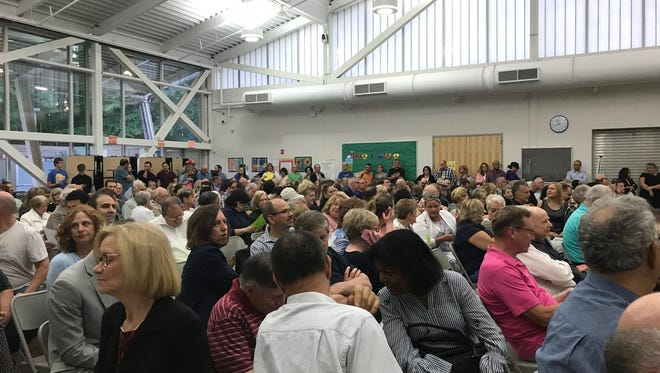 Hundreds of people showed up at Thursday's East Brunswick Zoning Board of Adjustment hearing on a controversial planned project. Due to the over capacity crowd, the meeting was postponed until July 16.