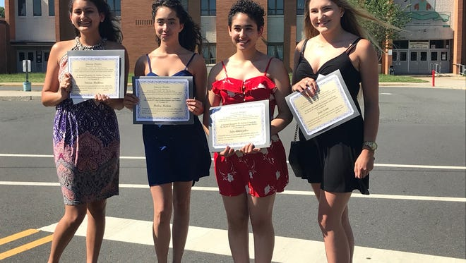 From left to right, Simran Modhera, Hailey Medina, Tala Abdeljaber and Jade Scotti each received a $1,000 Ionracas Deontas award for leading the March 14 walkout at their high school in support of those who lost their lives in the Parkland, Fla., shooting, as well as to foster support for gun control and school safety.