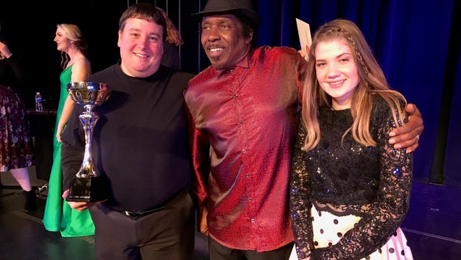 William Reed, left, poses with third-place winner Carl Garvin and runnerup Alyvia Colvin after results of the 2018 Abilene Idol competition were announced