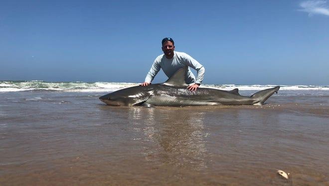 Joe Jarolik, of Rogers, caught and released this 9-foot, 2.5-inch bull shark while fishing on Padre Island National Seashore.