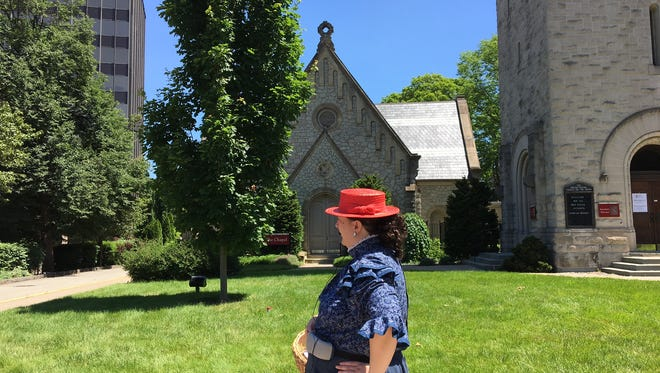 Historic Morristown Walking Tour guide Bonnie-Lynn Nadzeika describes the roots of the Presbyterian Church to her tour group on June 16, 2018.