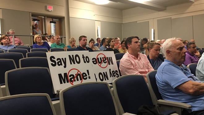 Residents opposed to Mane USA's proposal to site a fragrance plant on Route 53 await a Morris Plains Planning Board vote June 26, 2018 on the application.