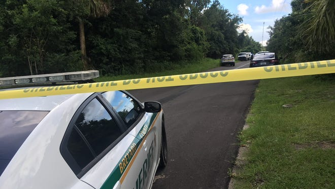 Bethune Avenue is cordoned off near Wiley Avenue in east Mims where crime scene investigators and medical examiners are looking into the dead body found in a burning car Monday afternoon.
