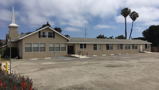 Harbor Community Church and an adjacent lot will be demolished and in its place will go four homes.