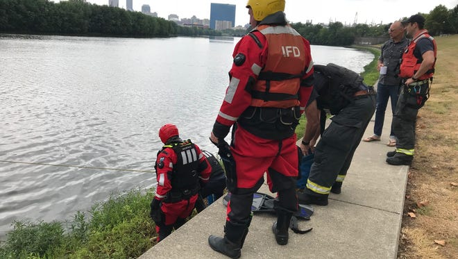 IFD rescue swimmers prepare to enter the White River on Sunday
